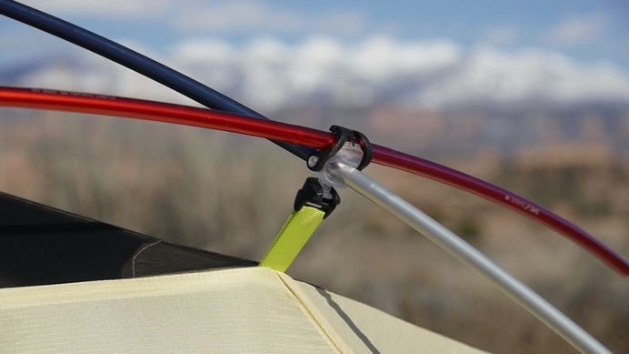 Below is an H-clip (on the tent) snapped to a Swivel-CHL (on the pole) which is holding the two crossing poles together to unitize the frame structure & The Poles | TheTentLab